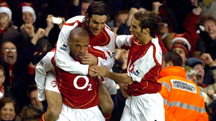 Thierry Henry celebrates scoring the first goal for Arsenal with team mates Mathieu Flamini and Robert Pires infront of fans