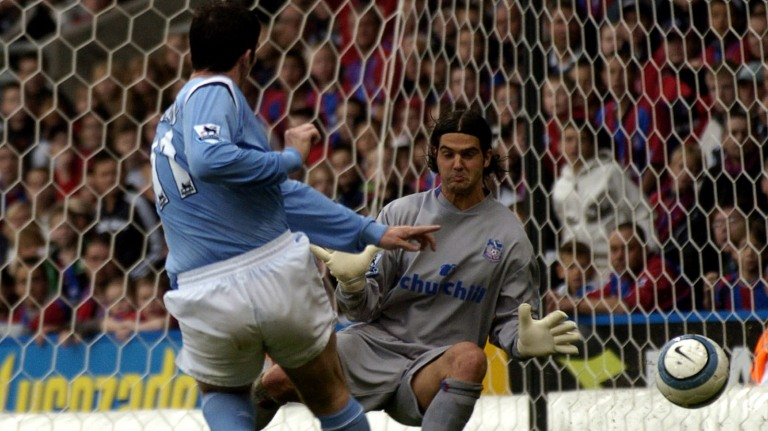 Jon Macken - Manchester City shoots at goal as Julian Speroni - Crystal Palace tries to save it