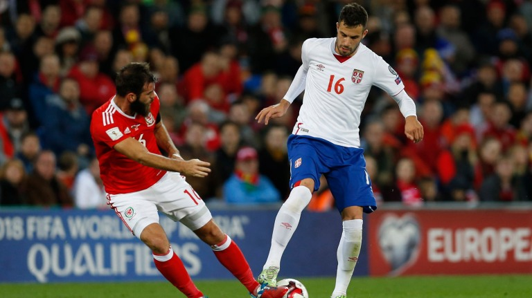 Wales' Joe Ledley in action with Serbia's Luka Milivojevic